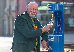 Youngsters paid tribute to one of Dumfries' most celebrated former residents when they unveiled a new water refill tap in the town.<br /> <br /> The high tech Top Up Tap has been installed by Scottish Water as part of its national initiative to encourage people to carry a reusable bottle and stay hydrated on the go. <br /> <br /> <br /> Pictured: Brian Gibson from one of the town's oldest businesses, whisky and wine specialists TH Watson. The experts, who run the area's Drambusters Whisky Club, sampled water from the new tap.