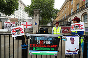 """London, United Kingdom, July 24, 2021: People holding banners and placards gathered outside Downing Street during a """"STOP the Genocide in Eastern Nigeria"""" demonstration in central London, on Saturday, July 24, 2021. (VX Photo/ Vudi Xhymshiti)"""