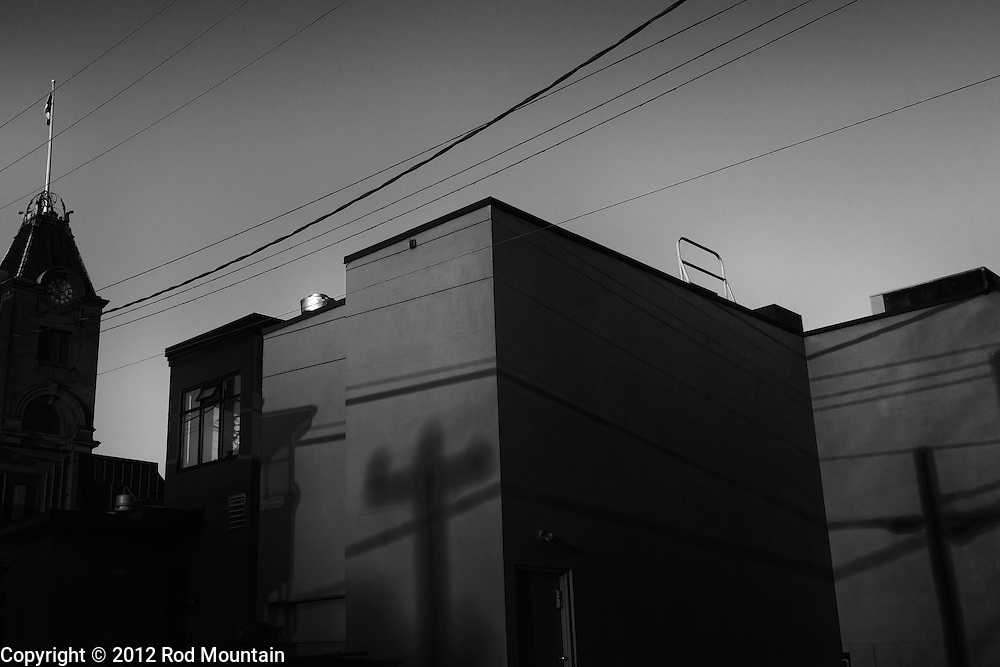 Shadows mark the back of a building as the sun rises in Vancouver, BC. Photo: © Rod Mountain
