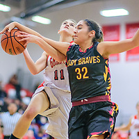 Grants Pirate Caroline Bachman (11), left, is fouled by Santa Fe Indian Brave Milan Schimmel (32) at the Grants Invitational girls basketball tournament at Grants High School Friday.