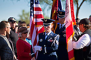 09 DECEMBER 2011 - PHOENIX, AZ:  Members of the color guard carry the colors out of the wreath laying ceremony at the National Ceremony in Phoenix. Several hundred volunteers and veterans gathered at the National Memorial Cemetery of Arizona in Phoenix Saturday to lay Christmas wreaths on headstones, a tradition started by Wreaths Across America. Wreaths Across America is a nonprofit organization founded to continue and expand the annual wreath laying ceremony at Arlington National Cemetery begun by Maine businessman, Morrill Worcester, in 1992.  PHOTO BY JACK KURTZ