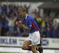 Fotball: Dunfermline v Rangers, Scottish Premier League, East EDnd Park, Dunfermline. Pic Ian Stewart, Saturday 11th. August 2001<br />Flo celebrates after scoring