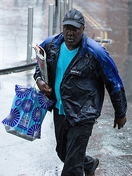 """© Licensed to London News Pictures . 23/10/2013 . Manchester , UK . AKINWALE AROBIEKE (aka PURPLE AKI ) arrives at Manchester Crown Court this morning (23rd October 2013) . Having been cleared of breaching a ban on touching men's muscles he now faces charges related to police harassment , namely he is alleged to have left Detective Sergeant Lewis Hughes """"to fear that violence would be used against him"""" following an incident in Birmingham Town Hall on 7th October 2012 . Photo credit : Joel Goodman/LNP"""