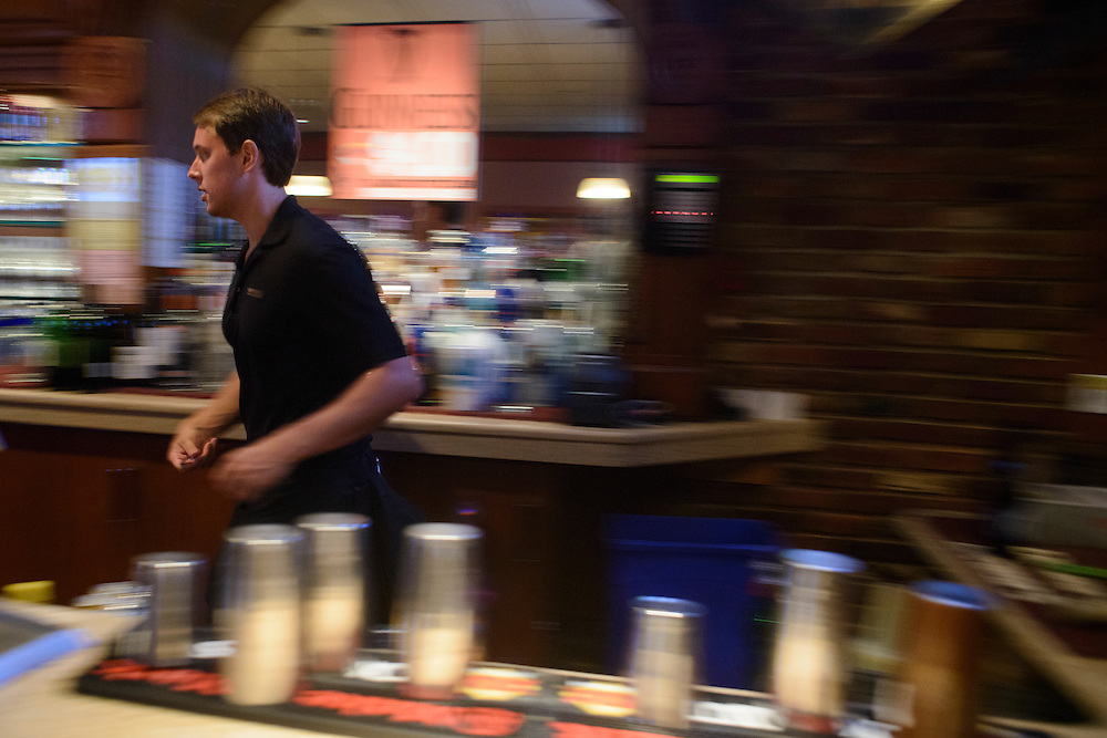 Photo by Matt Roth<br /> Assignment ID: 30144892A<br /> <br /> Vince Ritter, 25, bar-tends at the Shanty Grille in Ellicott City, Maryland Saturday, July 06, 2013. He turns 26 the following Monday and will be kicked off his parents health insurance plan. He will start a new full-time job with benefits at First Mariner Bank the week after his birthday. He still plans to work at Shanty Grille, but only on the weekends.