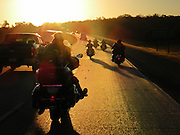 The Cycle Saints chapter of the Christian Motorcycle Association travel down I-40 early in the morning for a rally in Harrah, OK.
