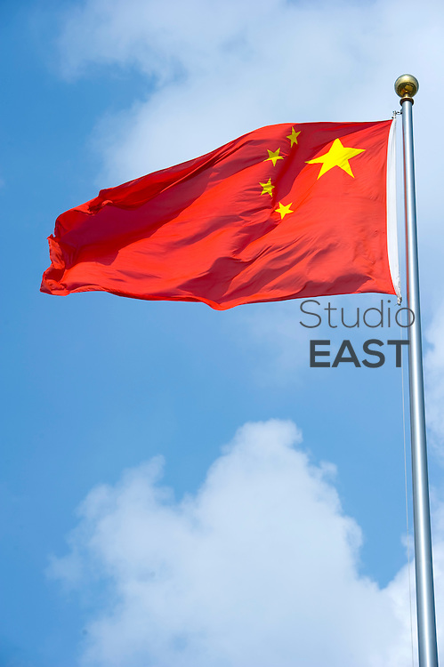 The Chinese flag flaps in the wind in Shanghai, China, on August 5, 2010. Photo by Lucas Schifres/Pictobank