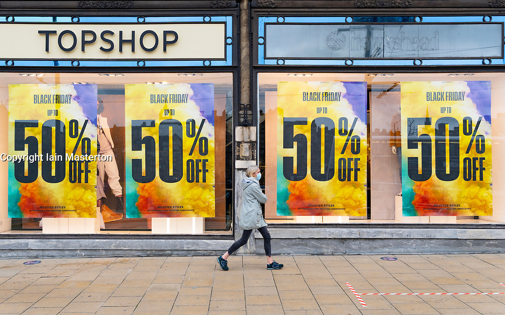Edinburgh, Scotland, UK. 20 November 2020. Shop window displays with posters offering large discounted sale prices on Black Friday in Edinburgh. Pictured; Sales posters in Top Shop on Princes Street. Iain Masterton/Alamy Live News