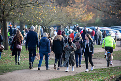 © Licensed to London News Pictures. 22/11/2020. London, UK. Members of the public go out to exercise  while enjoying the warm autumnal sunshine in Richmond Park, South West London as Prime Minister Boris Johnson is set to announce an end to the current lockdown. The Prime Minister is expected to address the Nation tomorrow to set out his plans for Christmas and the end of lockdown 2.0 on the 2nd of December 2020 with the opening up of shops, pubs and restaurants. However it is believed he will also introduce a new tougher three-tiered system with further localised restriction. Photo credit: Alex Lentati/LNP