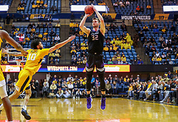 Feb 18, 2019; Morgantown, WV, USA; Kansas State Wildcats forward Dean Wade (32) shoots during the first half against the West Virginia Mountaineers at WVU Coliseum. Mandatory Credit: Ben Queen-USA TODAY Sports