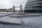 With very few people out and about the scene at More London near to City Hall loooking towards Tower Bridge is one of empty desolation on the riverside walkway as the national coronavirus lockdown three continues on 28th January 2021 in London, United Kingdom. Following the surge in cases over the Winter including a new UK variant of Covid-19, this nationwide lockdown advises all citizens to follow the message to stay at home, protect the NHS and save lives.
