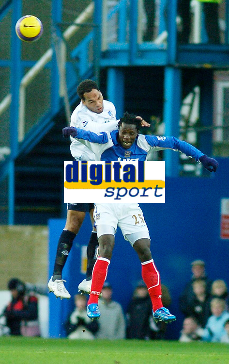 Photo: Gareth Davies.<br />Portsmouth v Everton. The Barclays Premiership. 09/12/2006.<br />Everton's Joleon Lescott (Top) wins the ball in the air from Portsmouth's Benjani (Bottom)