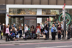 © Licensed to London News Pictures. 08/07/2015. London, UK. City workers queuing to at a bus near Liverpool Street station in London. London transport workers begin strike action tonight, which will continue tomorrow. Photo credit : Vickie Flores/LNP