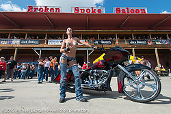 Angela Renner of Minneapolis, MN poses with her custom Harley bagger at the Broken Spoke Saloon during the 75th Annual Sturgis Black Hills Motorcycle Rally.  SD, USA.  August 6, 2015.  Photography ©2015 Michael Lichter.