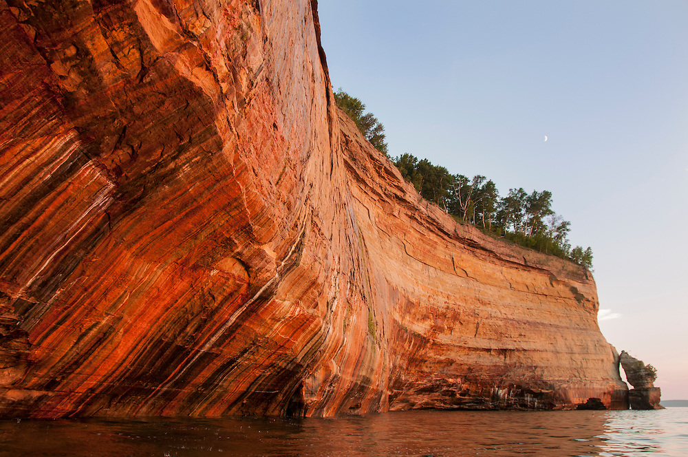 The colorful mineral streaks seeping from sandstone cliffs give Pictured Rocks National Lakeshore its name near Munising, Michigan on Michigan's Upper Peninsula.