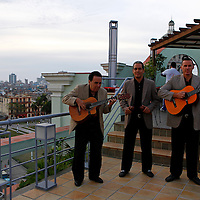 Central America, Cuba, Havana. Cuban musicians play on the rooftap of Hotel Saratoga in Havana.
