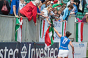 Chiara Tiddi of Italy celebrates with supporters after their victory in the penalty shoot out in their match against South Africa in the Investec Hockey World League Semi Final 2013, Quintin Hogg Memorial Sports Ground, University of Westminster, London, UK on 29 June 2013. Photo: Simon Parker
