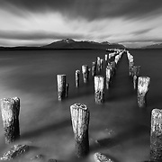 A famous old pier in Puerto Natales, Chile. Its so far south you feel as though its the end of the earth. A long exposure blurs the waves and clouds. - pbb