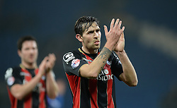 Bournemouth's Charlie Daniels claps the traveling fans. - Photo mandatory by-line: Alex James/JMP - Mobile: 07966 386802 - 17/03/2015 - SPORT - Football - Cardiff - Cardiff City Stadium - Cardiff City v AFC Bournemouth - Sky Bet Championship