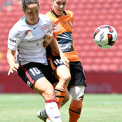 BRISBANE, AUSTRALIA - JANUARY 7: Katrina Gorry of the Roar and Paige Nielsen of the Wanderers compete for the ball during the round 11 Westfield W-League match between the Brisbane Roar and Western Sydney Wanderers at Suncorp Stadium on January 7, 2017 in Brisbane, Australia. (Photo by Patrick Kearney/Brisbane Roar)