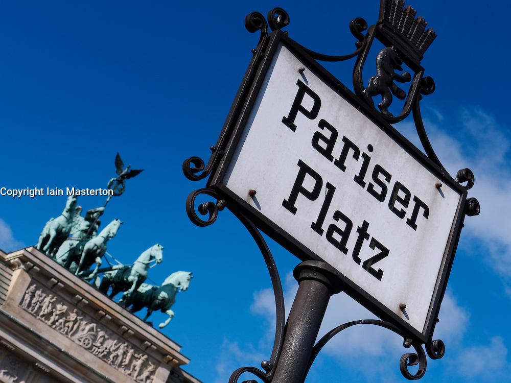 Pariser Platz sign and Quadriga on Brandenburg Gate in Berlin