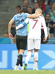 SOCHI, June 30, 2018  Portugal's Cristiano Ronaldo (R) helps injured Uruguay's Edinson Cavani walking out of the pitch during the 2018 FIFA World Cup round of 16 match between Uruguay and Portugal in Sochi, Russia, June 30, 2018. Uruguay won 2-1 and advanced to the quarter-final. (Credit Image: © Fei Maohua/Xinhua via ZUMA Wire)