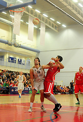 Bristol Academy Flyers' Enrique Garcia is blocked by Essex Leopards' Greg Hernandez - Photo mandatory by-line: Dougie Allward/JMP - Tel: Mobile: 07966 386802 23/03/2013 - SPORT - Basketball - WISE Basketball Arena - SGS College - Bristol -  Bristol Academy Flyers V Essex Leopards