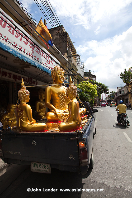 Bamrung Muang Road near Bangkok City Hall and Wat Suthat is the largest center for Buddhist supply shops in the country. Originally an elephant trail, this was one of the first roads to be paved in Bangkok. Here you can pick up a giant Buddha, delivery not included in the price. A variety of shops sell Buddhist paraphernalia: giant orange candles, monks robes, and statues of all sizes.