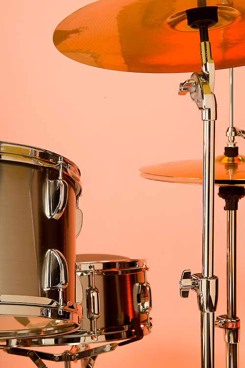 Orange lit drums and cymbals