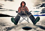 Waiting for the bite. Spring ice fishing in the Yukon, Canada.