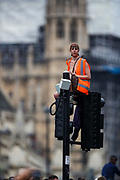 London, United Kingdom, June 27, 2021: A protestor is seen on top of a lamp stamp during an anti-government musical rave in central London with police dispersing the crowds on Sunday, June 27, 2021. (VX Photo/ Vudi Xhymshiti)