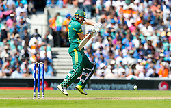 AB de Villiers (capt) of South Africa guides the ball down to third man