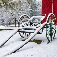 New England snow covered horse-drawn carriage in front of the red barn at the Longfellow's Wayside Inn. The Wayside Inn Historic District is located in Sudbury, Massachusetts. <br /> <br /> Horse-Drawn Carriage at the Wayside Inn Historic District winter photos are available as museum quality photo, canvas, acrylic, wood or metal prints. Wall art prints may be framed and matted to the individual liking and interior design decoration needs:<br /> <br /> https://juergen-roth.pixels.com/featured/red-barn-and-horse-drawn-carriage-juergen-roth.html<br /> <br /> Good light and happy photo making!<br /> <br /> My best,<br /> <br /> Juergen