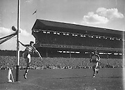 Goalkeeper kicks ball wide during the Down v Offaly All Ireland Senior Gaelic Football Final in Croke Park on 24th September 1961. Down 3-6 Offaly 2-8.