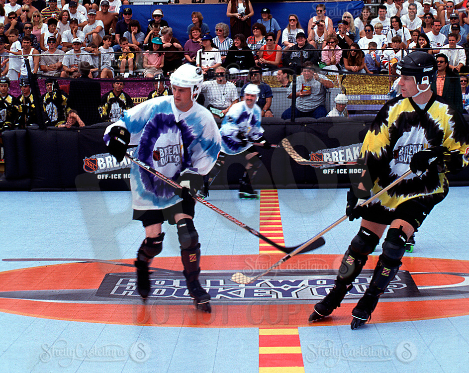 Aug 22, 1996; Santa Monica, California, USA; Actor Matthew Perry in-line skating at the beach a taping of the Hollywood Hockey Cup at the '96 NHL Breakout in the parking lot south of the Santa Monica Pier in California.  Perry grew up in Canada playing ice hockey and picked up roller hockey when he  moved to Los Angeles.  Mandatory Credit: Photo by Shelly Castellano/ZUMA Press. (©) Copyright 1996 by Shelly Castellano