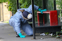 © Licensed to London News Pictures. 12/05/2019. London, UK. A forensics officer on Tollington Road, Islington in north London as Met police launch an investigation into the death of a man who was found in a wheelie bin behind a Waitrose store, at the junction of Annette Road, shortly before 4pm on Saturday 11 May 2019. Photo credit: Dinendra Haria/LNP