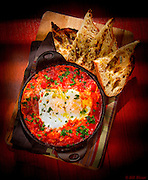 Shakshuka -- a Middle Eastern dish of eggs poached and baked in a spicy tomato sauce -- here at the 27 Restaurant in Miami Beach's Freehand Hotel.