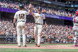 June 3, 2018 - San Francisco, CA, U.S. - SAN FRANCISCO, CA - JUNE 03: San Francisco Giants Second base Joe Panik (12) and San Francisco Giants Catcher Buster Posey (28) congratulate each other after being driven in by a 3-run homer by San Francisco Giants Right field Andrew McCutchen (22) during the MLB game between the Philadelphia Phillies and San Francisco Giants on June 3, 2018, at AT&T Park in San Francisco, CA. (Photo by Bob Kupbens/Icon Sportswire) (Credit Image: © Bob Kupbens/Icon SMI via ZUMA Press)