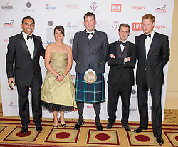 Team Glenfiddich, Capt. Ibi Ali MC, Major Kate Philp, Sgt. Duncan Slater, Capt. Guy Disney and Prince Harry, Capt. Harry Wales<br /> Prince Harry, Patron of the Walking With The Wounded South Pole Allied Challenge, attends the charity's Crystal Ball at the Grosvenor House Hotel, central London.<br /> The event hosted by Ben Fogle, with music Ellie Goulding and The Stereophonics. Also present were Olympian Matthew Pinsent CBE and Team Glenfiddich. The team of wounded service personnel will accompany the Prince on an expedition to the South Pole later this year, London,<br /> Thursday, 30th May 2013<br /> Picture by Anthony Upton / i-Images