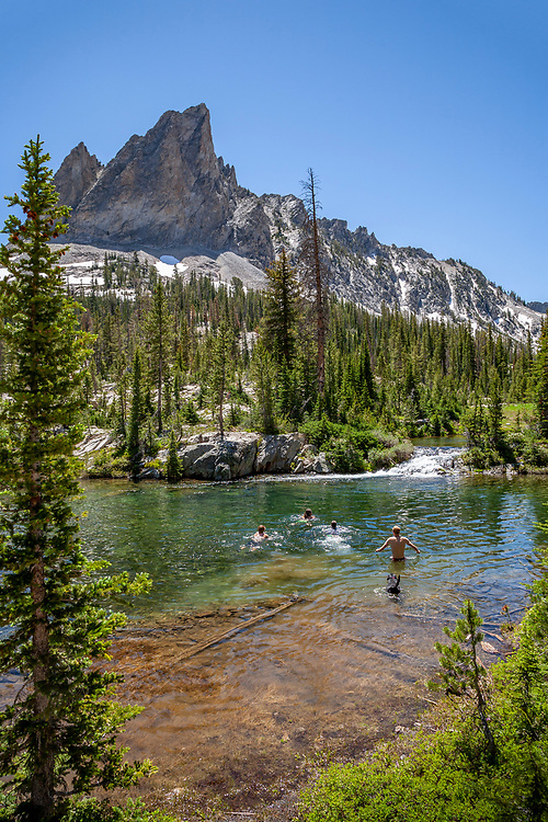 Blue a black Labrador retriever joins the fun cooling off in Alice Lake with 2 couples on a beautiful summer day with El Capitan Peak in background 9902 feet / 3018 meters.  Licensing and Open Edition Prints. MR