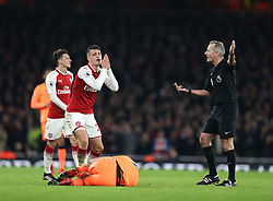 22 December 2017 London : Premier League Football : Arsenal v Liverpool : Granit Xhaka of Arsenal reacts in disbelief at a decision by referee Martin Atkinson.<br /> (photo by Mark Leech)
