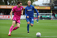 AFC Wimbledon striker Joe Pigott (39) battles for possession with Rochadale defender Jordan Williams (8) during the EFL Sky Bet League 1 match between AFC Wimbledon and Rochdale at the Cherry Red Records Stadium, Kingston, England on 5 October 2019.