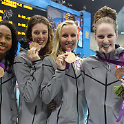 The USA team of Lia Neal, Allison Schmitt, Jessica Hardy, and Missy Franklin winning the silver medal in the women's 4 x 100m freestyle relay final during the swimming finals at the Aquatic Centre at Olympic Park, Stratford during the London 2012 Olympic games. London, UK. 28th July 2012. Photo Tim Clayton