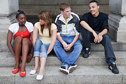Teenage group sitting on steps.
