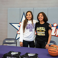 Teammates Miyamura Lady Patriot Fetisha Johnson, left, signed a letter of intent in February to attend Haskell Indian Nations University and play for the Fightin' Indians women's basketball team, Odessa Begay, right, signed a letter of intent with Haskell Indian Nations University, Friday, April 12 at Miyamura High School.