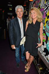 JOHN FRIEDA and his wife AVERY at Hoping's Greatest Hits - the 10th Anniversary of The Hoping Foundation's charity benefit held at Ronnie Scott's, 47 Frith Street, Soho, London on 16th June 2016.
