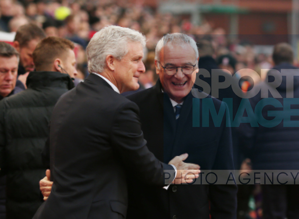Mark Hughes manager of Stoke City greets Claudio Ranieri manager of Leicester City during the English Premier League match at the Bet 365 Stadium, Stoke on Trent. Picture date: December 17th, 2016. Pic Simon Bellis/Sportimage