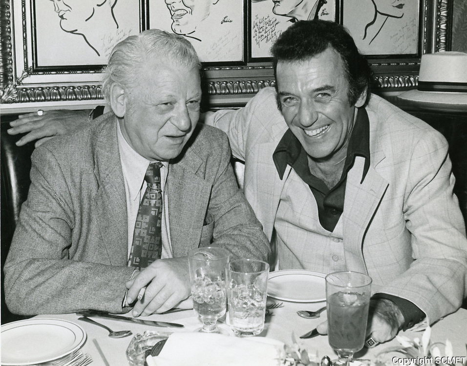 1977 Comedian Norm Crosby and columnist Jack Kaufman having dinner at the Brown Derby Restaurant on Vine St. in Hollywood