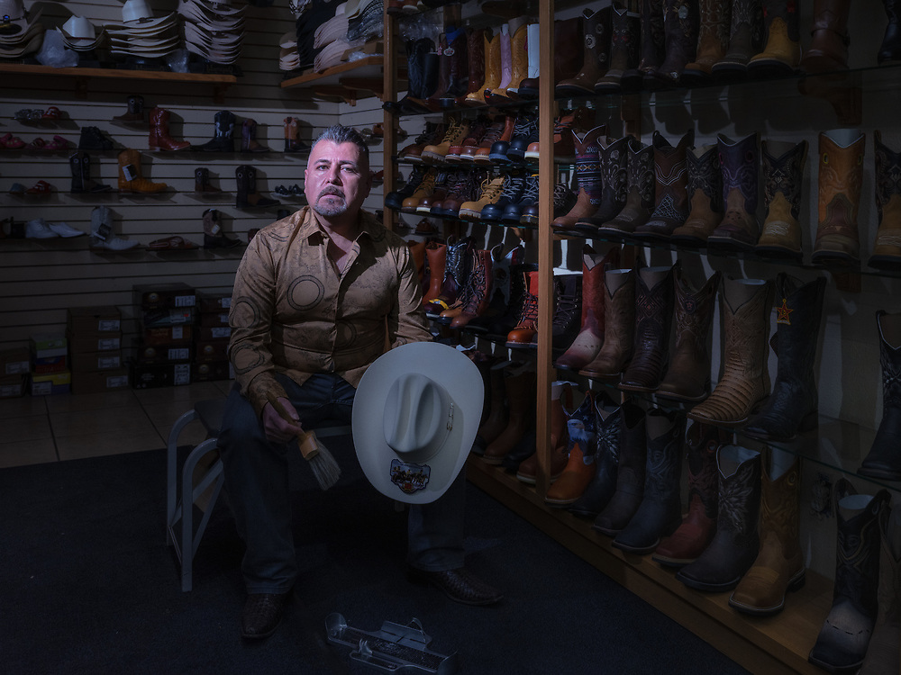 """Guadalupe Venegas, owner of Los Tres Potrillos Western Wear. Northgate Blvd., Sacramento.<br /> <br /> I've been in business for 23 years. it's really slow right now; no weddings, no quinceañera, and no soccer. Business went down 80%. I am behind on my rent and I know the landlord wants their money.  When this pandemic started, I closed for five weeks. I was just staying home and I ran out of money. One Sunday, my wife asked me, """"Hey, can I get some money to go buy groceries?"""" And I had to tell her I didn't have it. And she asked me again, """"What do you mean you don't have it? I said, """"You didn't hear what I said, I don't have it!"""" I kind of got angry but inside I was feeling bad. I was feeling so sad that I had to tell my wife that."""