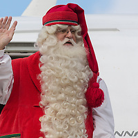 Finnish man dressed as Santa Claus named Joulupukki in Finland waves as he arrives to participate in the traditional Christmas celebrations in Budapest, Hungary on November 30, 2012. ATTILA VOLGYI