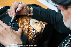 Willie G. Davidson has an autograph session during Wednesday's Ride-In Bike Show at the Harley-Davidson display during Daytona Bike Week. FL, USA. March 12, 2014.  Photography ©2014 Michael Lichter.